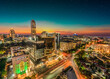 canvas print picture - Sandton city illuminated at night in Gauteng Johannesburg South Africa