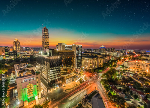 Fotografie, Obraz Sandton city illuminated at night in Gauteng Johannesburg South Africa