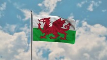 Wales Flag Waving In The Blue Sky Realistic 4k Video.
