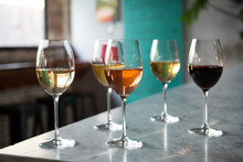 Many Glasses Of Wine On A Bar