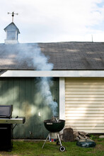 A Charcoal Grill Smoking