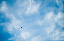 Green Balloon Floating Away