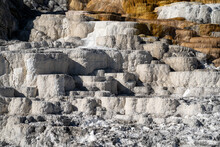 Travertine Terraces Of Mammoth Hot Springs Area Of Yellowstone National Park In The Bright Sunshine