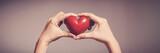 Fototapeta Kawa jest smaczna - Woman holding red heart, health insurance, donation, happy charity volunteer concept, world mental health day, world heart day