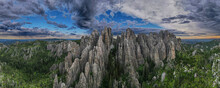 Panorama Of Needles Spires With Storm Clouds In The Background Off Needles Highway In Black Hills Of South Dakota