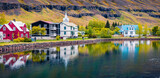 Panoramic morning cityscape of small fishing town - Seydisfjordur. Wonderful summer scene of east west Iceland, Europe. Traveling concept background.