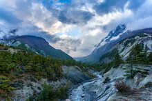 A River Flowing Down The Mountain And Glacier Covered By Clouds Near Bhraka, Manang Nepal. A Moody Scenery In Annapurna Circuit Trekking Trail.
