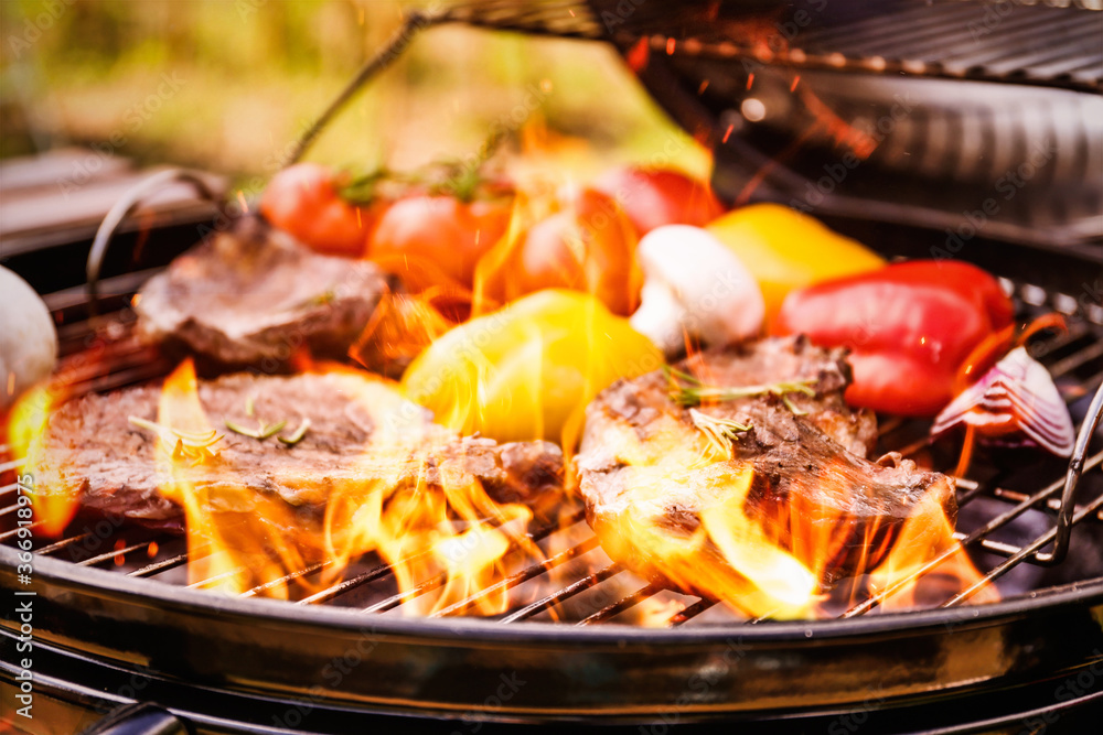 Fototapeta Barbecue grill with food and flame, closeup