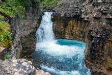 Beautiful Waterfall Among Rock...