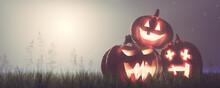 Halloween Pumpkins On Grass At...