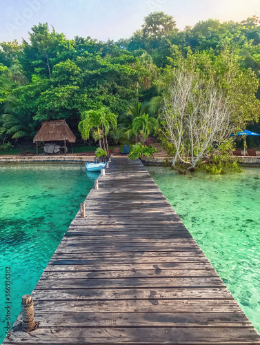 Tela Bacalar, Quintana Roo / Mexico - August 23, 2018: Wooden pier in a resort at Bac