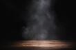 empty wooden table with smoke float up on dark background