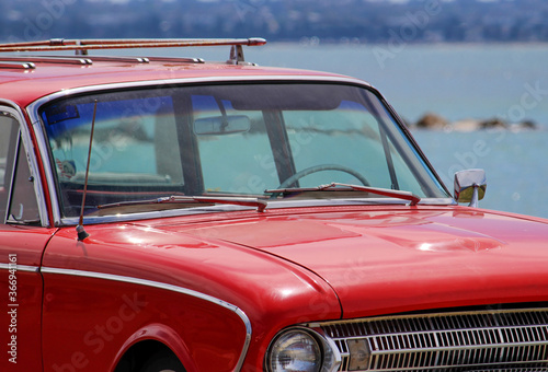 Vintage red car parked by the beach. Silver beach, Sydney. фототапет