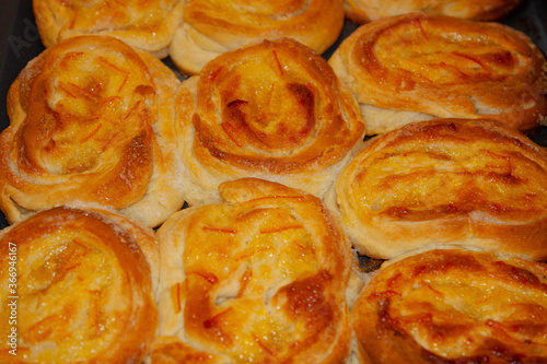 Hot buns on a dish, dredge dough, sprinkled with sugar and anointed with orange Canvas Print