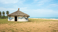 Hut With A Thatched Roof In Africa Coast