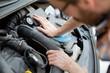 A man fixing a car. Self automobile repair.