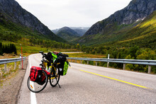 LOFOTEN, NORWAY - SEPTEMBER 10, 2019:  Heavy Loaded Bicycle With Panniers And Bags In Lofoten, Norway - Popular Tourist And Cyclist Destination In Scandinavia