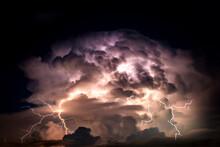 Dark Cloud At  Night With Thunder Bolt. Heavy Storm Bringing Thunder, Lightnings And Rain In Summer.