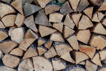 Stack Of Firewood. The Firewood Is Neatly Stacked