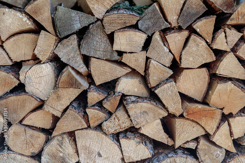 stack of firewood. The firewood is neatly stacked Wallpaper Mural