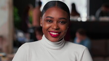 Portrait Of Happy Young Beautiful 20s Gen-z Black Business Woman With Red Lips Smiling At Camera At Light Trendy Office.
