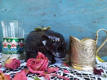Still Life Ceramic Brown Elephant For Dry Tea Cup Holder Roses Cookies With Jam Glass On The Lace Tablecloth