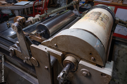 Tablou Canvas Antique press in use in a print shop