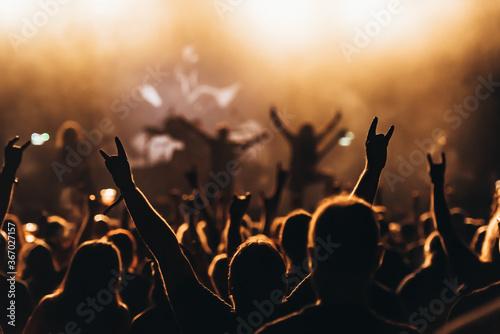 Rock fan showing a heavy metal rock sign