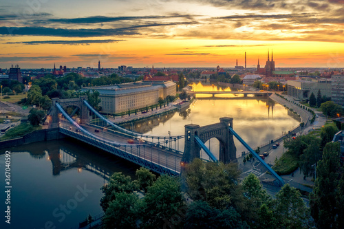 Aerial view from drone on the Grunwaldzki Bridge at sunset Wallpaper Mural