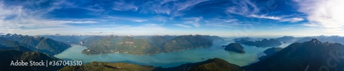 Fototapeta Aerial Panoramic View of Howe Sound and Beautiful Canadian Mountain Landscape during sunny and cloudy day. Taken near Squamish and Vancouver, British Columbia, Canada. Nature Background Panorama obraz