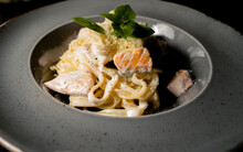 Italian Fettuccine Pasta With Salmon In A Creamy Sauce