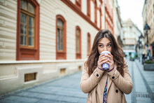 Young Stylish Woman Drinking C...