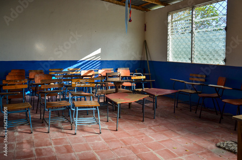 Fototapeta Inside a classroom with chairs and desks in a public school class in Nicaragua