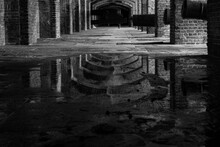 Reflection In Puddle At Fort Z...