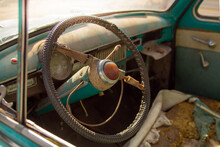 The Interior Of A Vintage Abandoned Car With Dust And Destruction