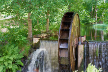 Rare Old Waterwheel On The River.