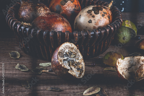 Valokuvatapetti Still Life with Rotten Fruits, view of broken fruit and window shadows