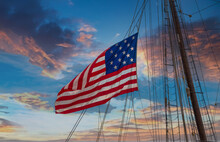 An American Flag Flying From The Riggings Of A Tall Ship