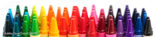 Fototapeta Row of crayons in a rainbow of colors isolated on white obraz