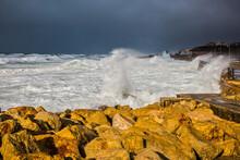 Huge Foaming Waves Beating Ag...