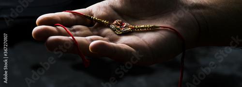фотография Rakhi in the hand for raksha bandhan