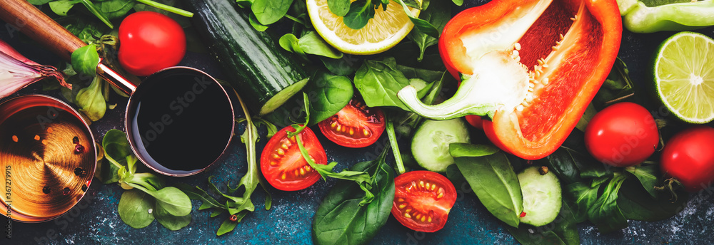 Fototapeta Fresh helthy food cooking or salad making ingredients on dark background with rustic wooden board. Diet or vegetarian food concept. Panoramic banner with copy space
