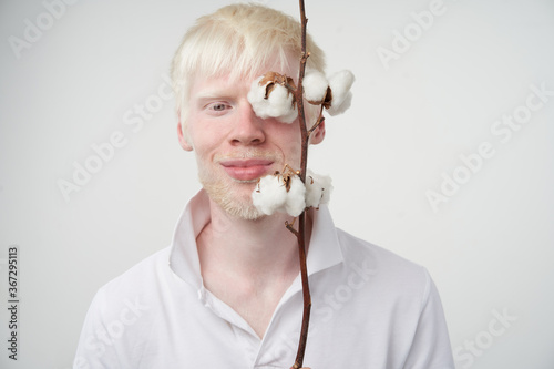 Fotografie, Tablou albinism albino man in studio dressed t-shirt isolated on a white background