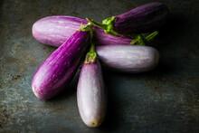 Fairy Tale Eggplants On A Dark...