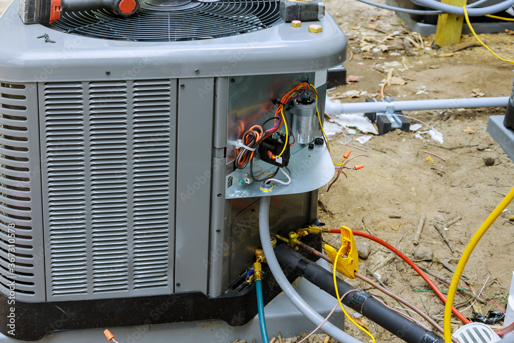Fototapeta Air conditioning technician of preparing to install new air conditioner.