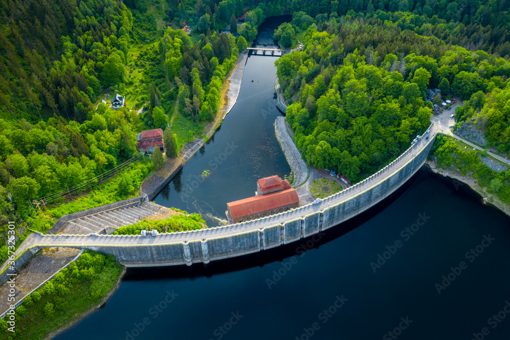 Dam and hydroelectric water power station. Concept of the clean energy. Aerial panoramic view of stone dam at reservoir in mountains. Drone shot at Pilchowice Lake, Poland