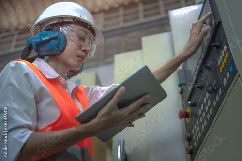 Photo Woman engineering in charge of working duty in dashboard controller of the machi