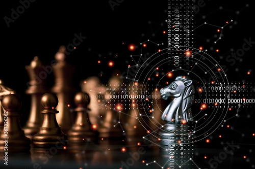 Silver horse chess encounters with gold chess enemy on chess board and black background Canvas-taulu