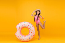 Lets Have Fun. Swimming Pool At Vacation. Donut Pool Party. Completely Happy. Child With Inflatable Rubber Having Fun On Beach. Childhood Happiness. Finally Summer Vacation. Energetic Small Girl