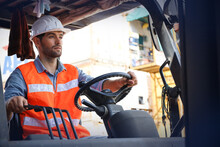 A Engineering Or Foreman Or Driver Working At Container Stock Yard With Drive A Loader Forklift Steering Wheel Control For Transport Handling